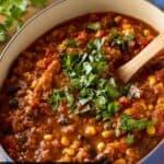 pumpkin chili in dutch oven with cilantro.
