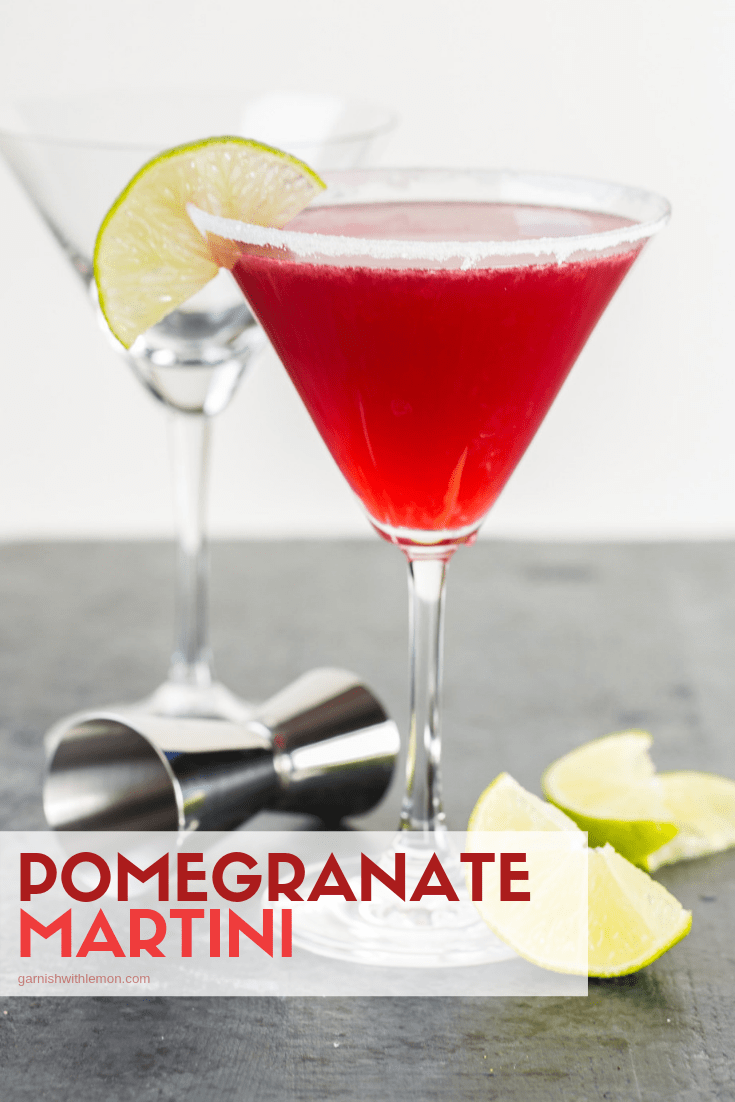 Pomegranate Martini recipe in tall martini glass with sugared rim and lime wedge for garnish.