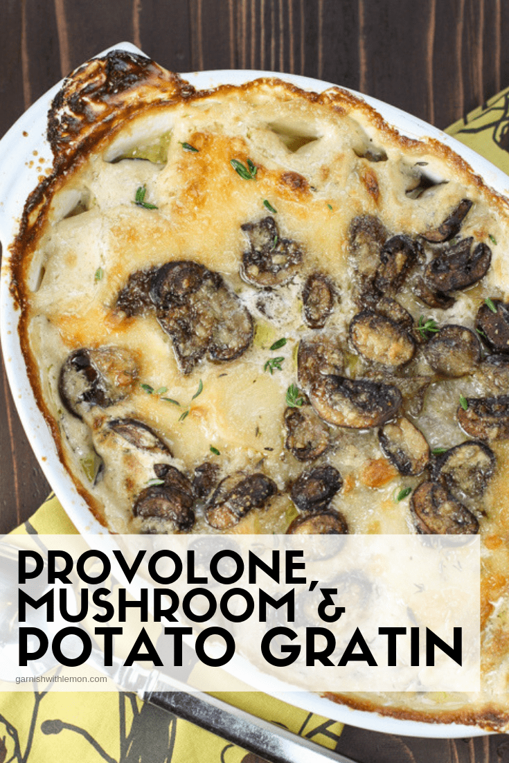 Top down image of Provolone Mushroom and Potato Gratin recipe on a dark brown surface.