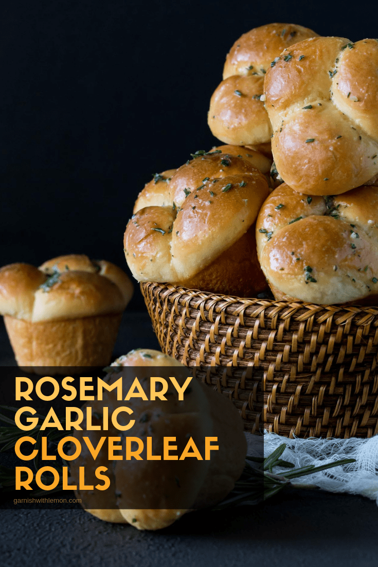 Top down image of Rosemary Garlic Cloverleaf Rolls brished with melted butter and sprinkled with Rosemary and salt.