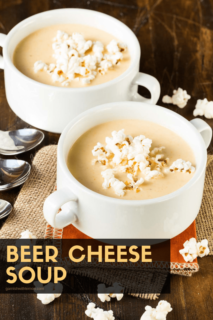 top down image of beer cheese soup with popcorn for garnish.