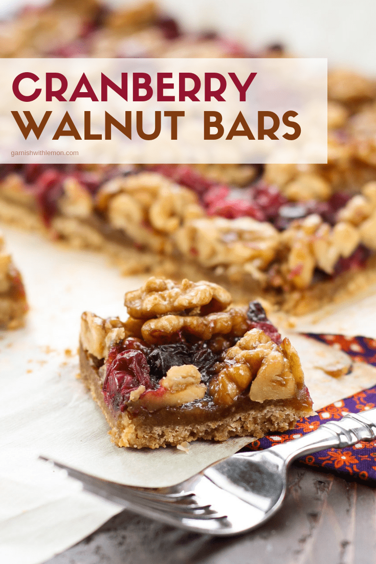 top down image of cut Cranberry Walnut bars on parchment.