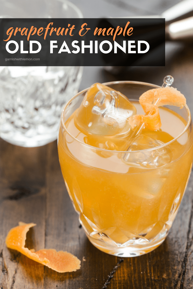 A close up of a glass of old fashioned with maple.