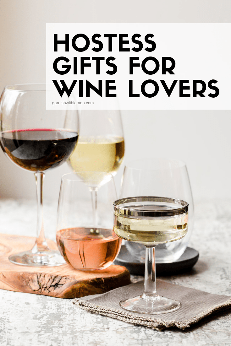 Image of wine glasses on tray for best hostess gifts for wine lovers.
