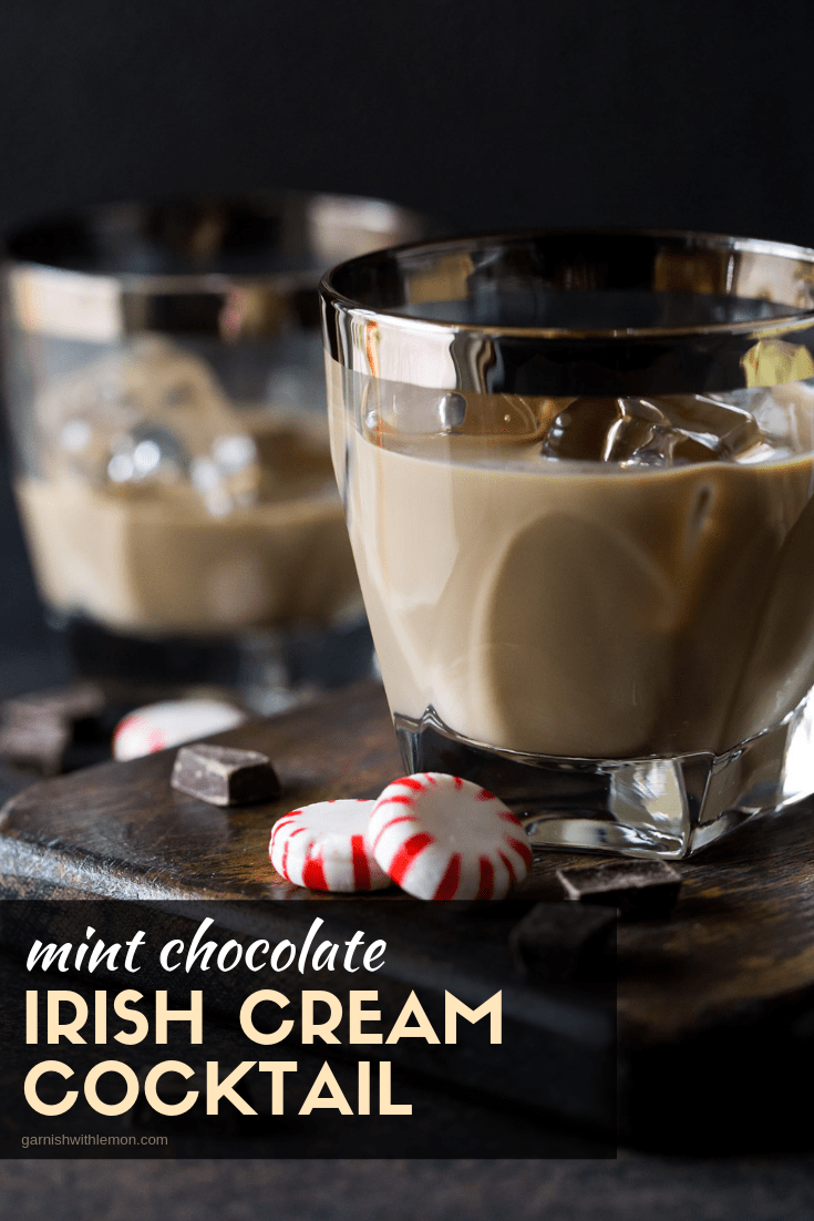 Straight on image of Mint Chocolate Irish Cream cocktail in a low ball glass with silver rim.