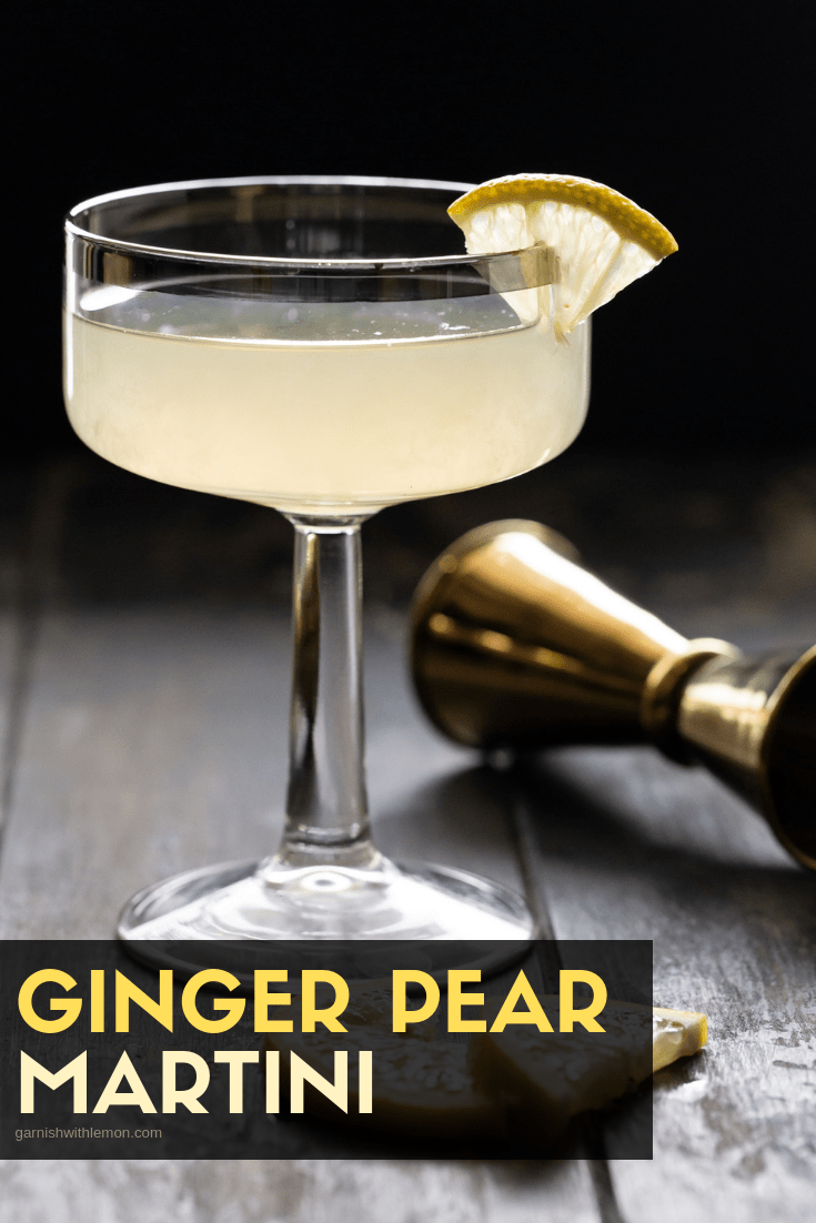 Ginger Pear Martini recipe in a coupe glass garnished with a small lemon slice.