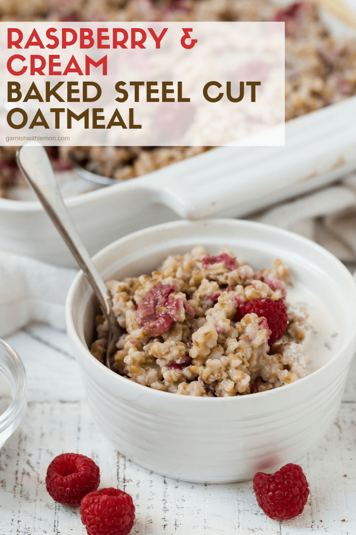 Raspberry and Cream Baked Steel Cut Oatmeal in white ramekins with small silver spoons for eating. Oatmeal is garnished with fresh raspberries and a splash of whipping cream.