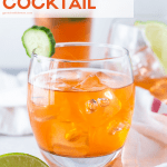 Pinterest image of Aperol Gin Cocktails in low ball glass with small cucumber slice for garnish.