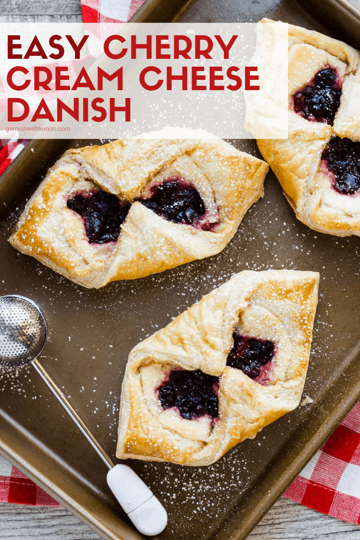 Easy Cherry Cream Cheese Danish dusted with powdered sugar on a sheet pan.