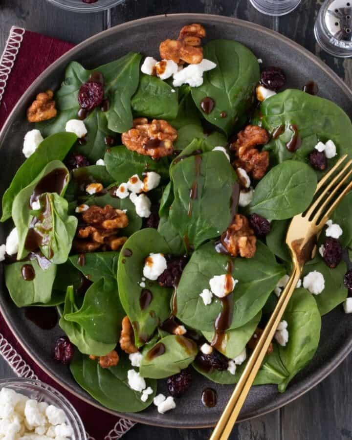 spinach salad on plate.