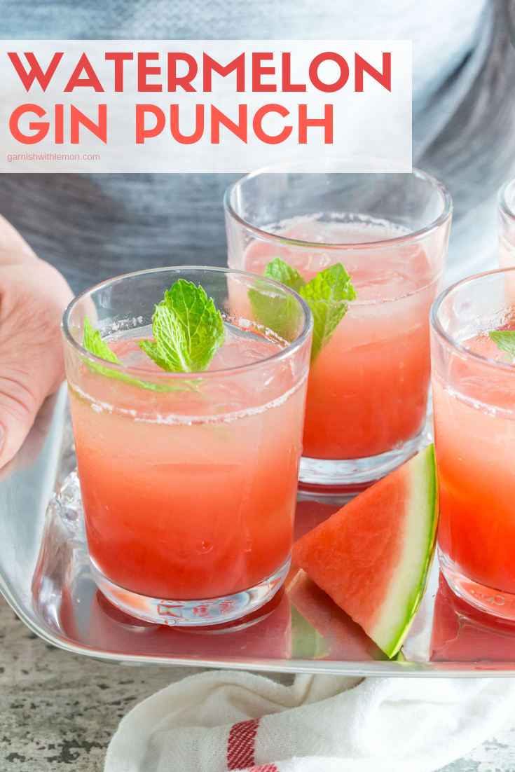 Watermelon Gin Punch in 3 low ball glasses on a silver tray.