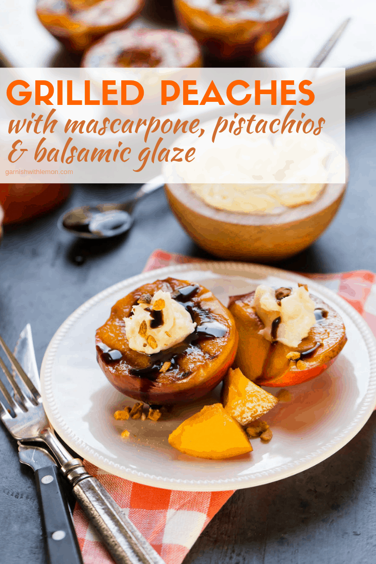 Grilled Peaches with Mascarpone Cheese Pistachios and Balsamic Glaze on a white plate on a dark background.