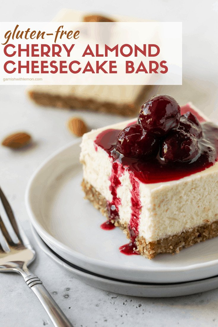 Small white plate filled with a slice of Gluten-Free Cherry Almond Cheesecake Bars.