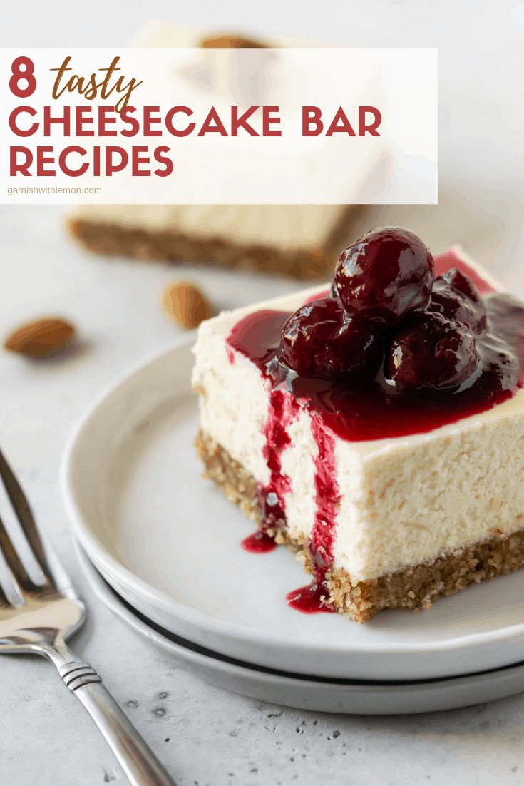 Cheesecake Bars on a small white plate with a fork and cherries.