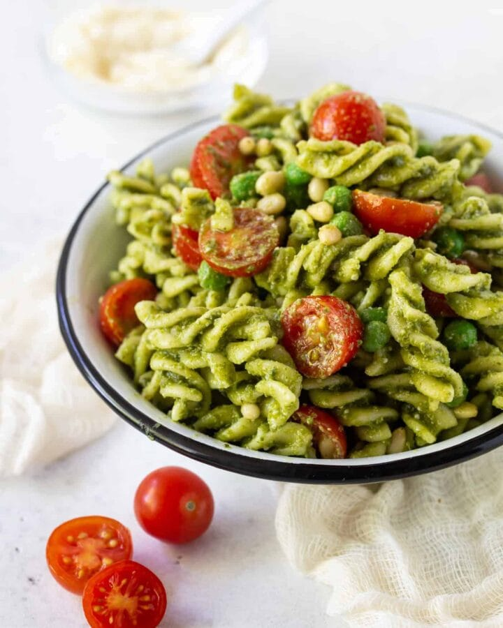 Pesto Pasta Salad with a white bowl with
