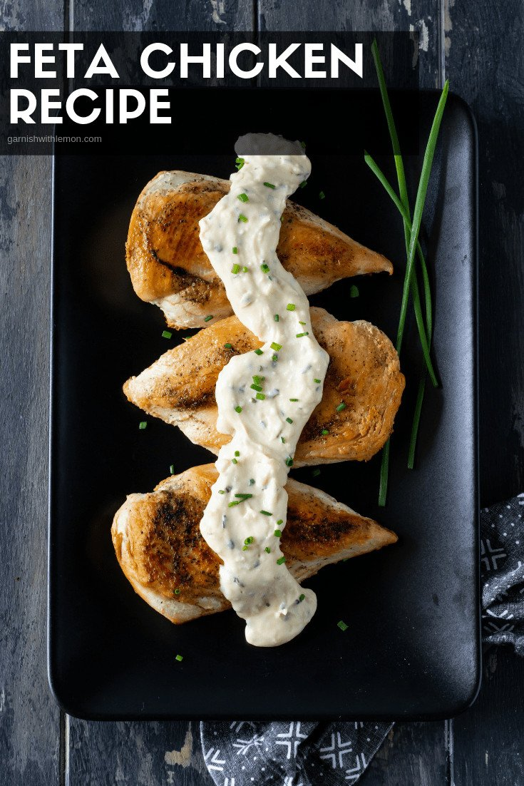 Chicken and Feta sauce on platter with chives.