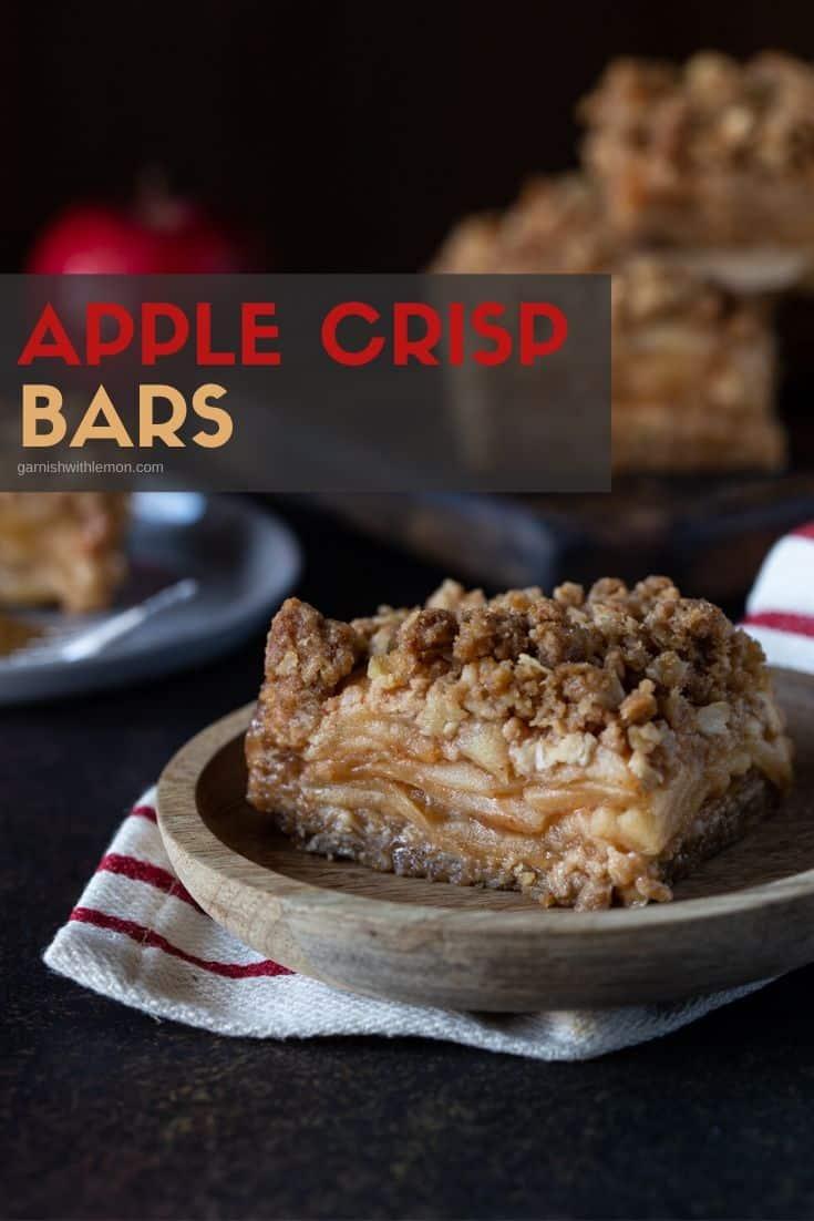 Apple Crisp bars on a wooden plate.