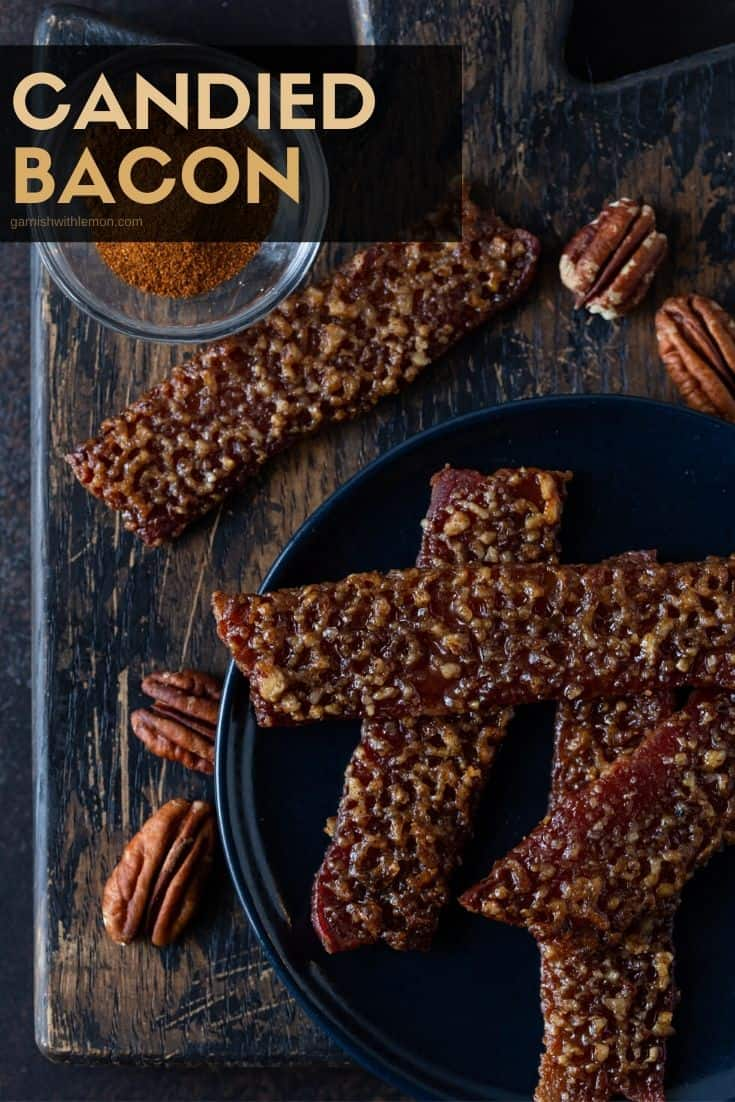 Pinterest image of Candied Bacon on a dark plate with pecans and cayenne pepper for garnishes.