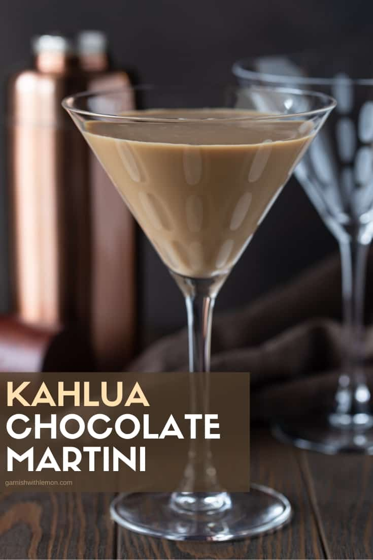 Pinterest image of Kahlúa chocolate martinis on a dark bronw background with a shaker in the background.