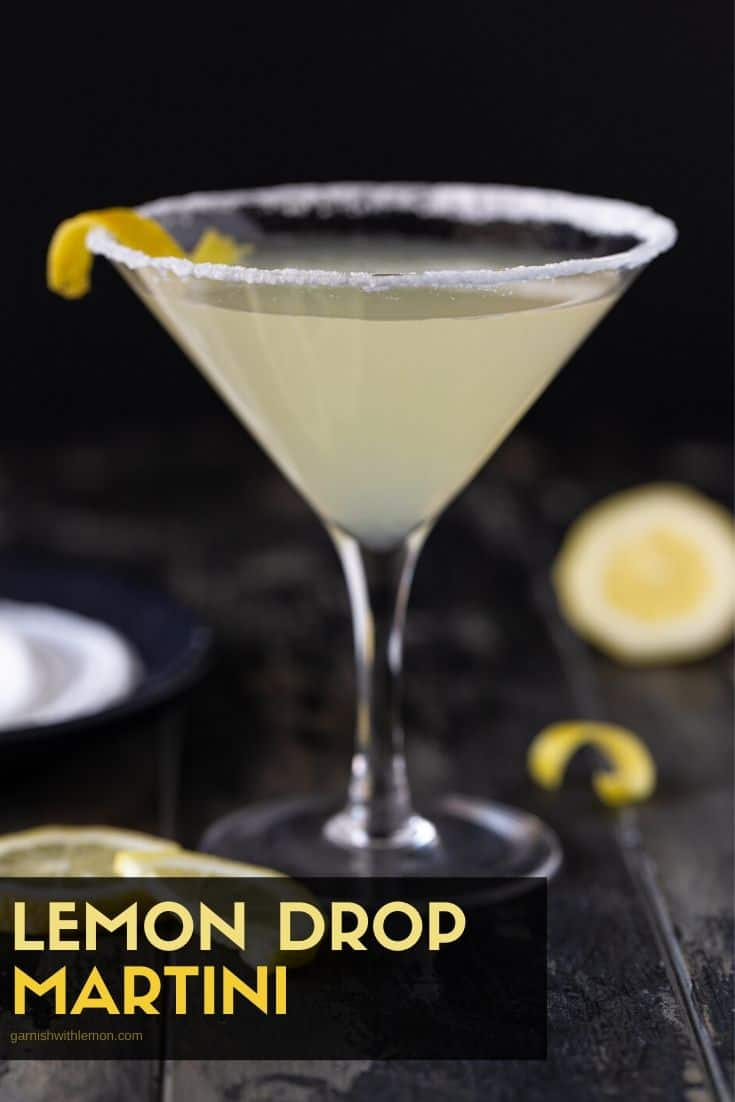 Pinterest image of Lemon Drop martini recipe in a single glass with lemon wedges for garnish.