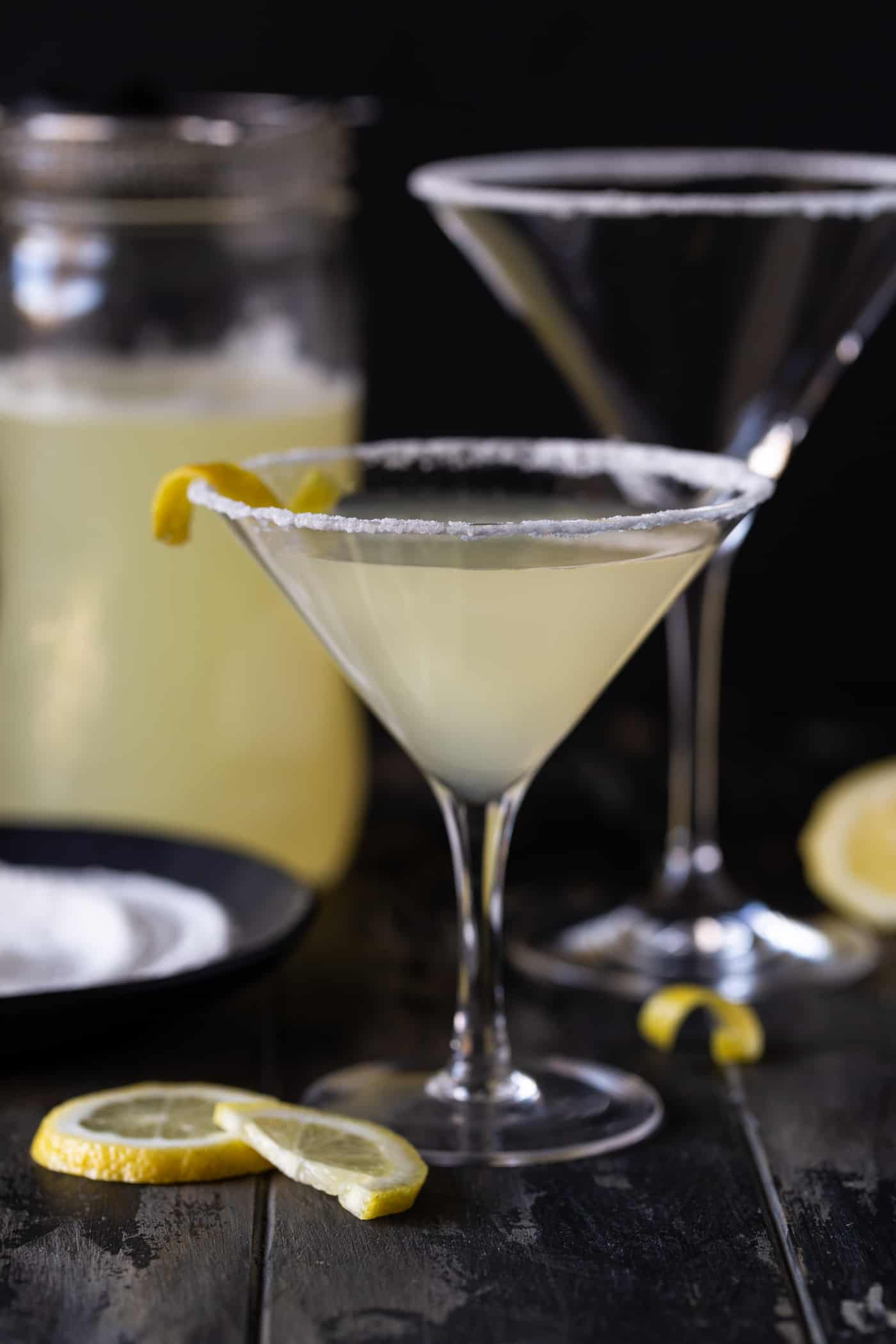 Single lemon drop martini is a short martini glass rimmed in sugar.