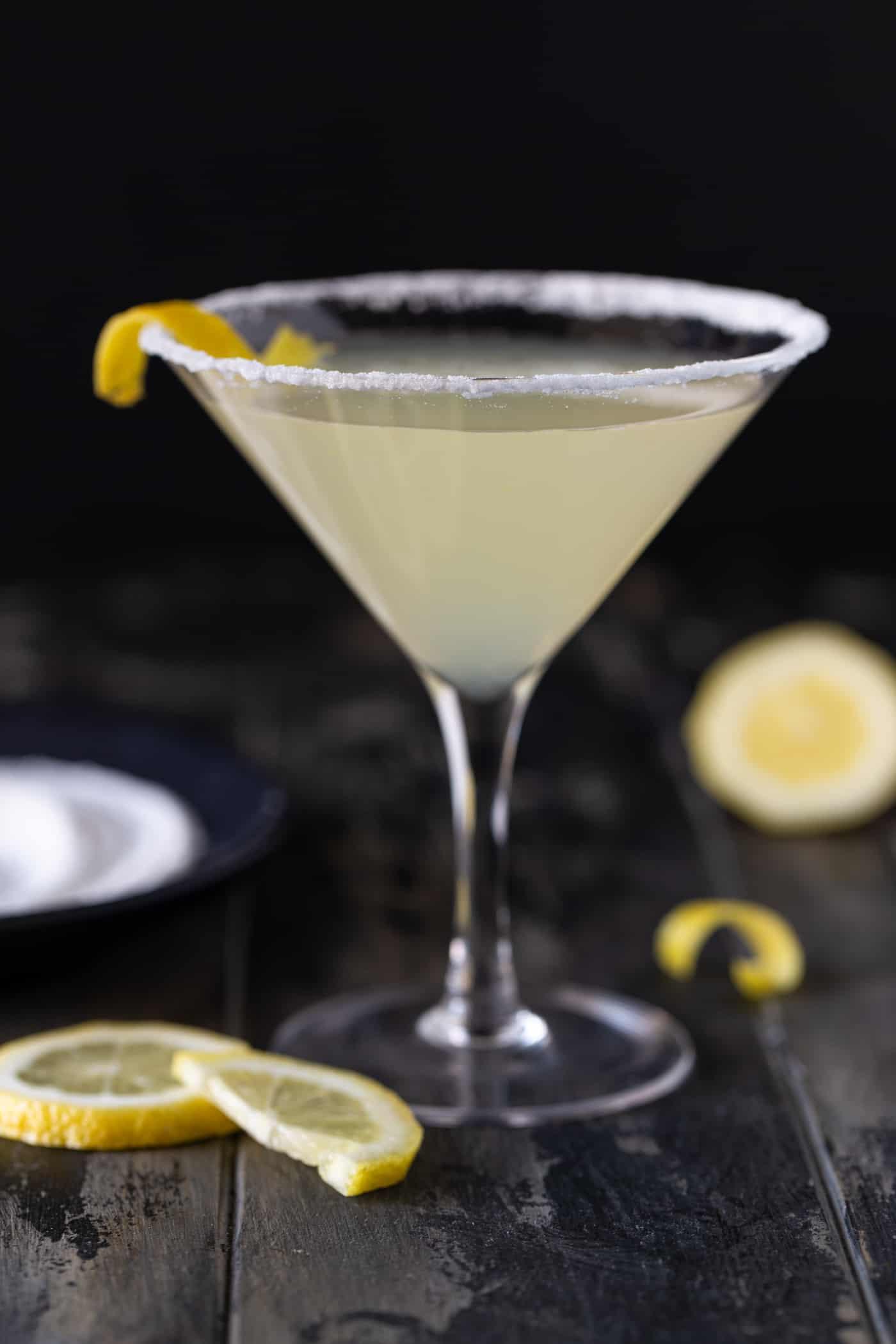 martini in a short martini glass a sugar rim and lemon twists for garnish.