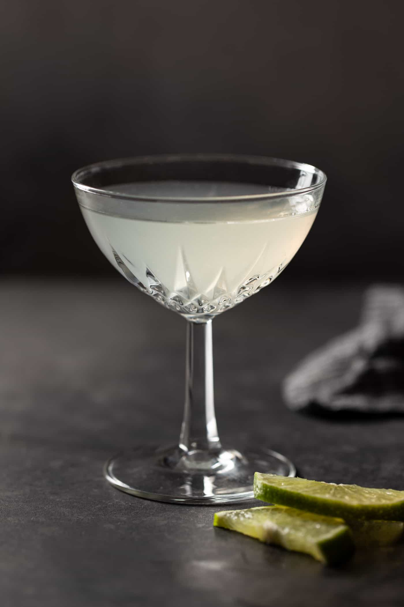 A single coupe glass filled with Elderflower Gin Gimlet.