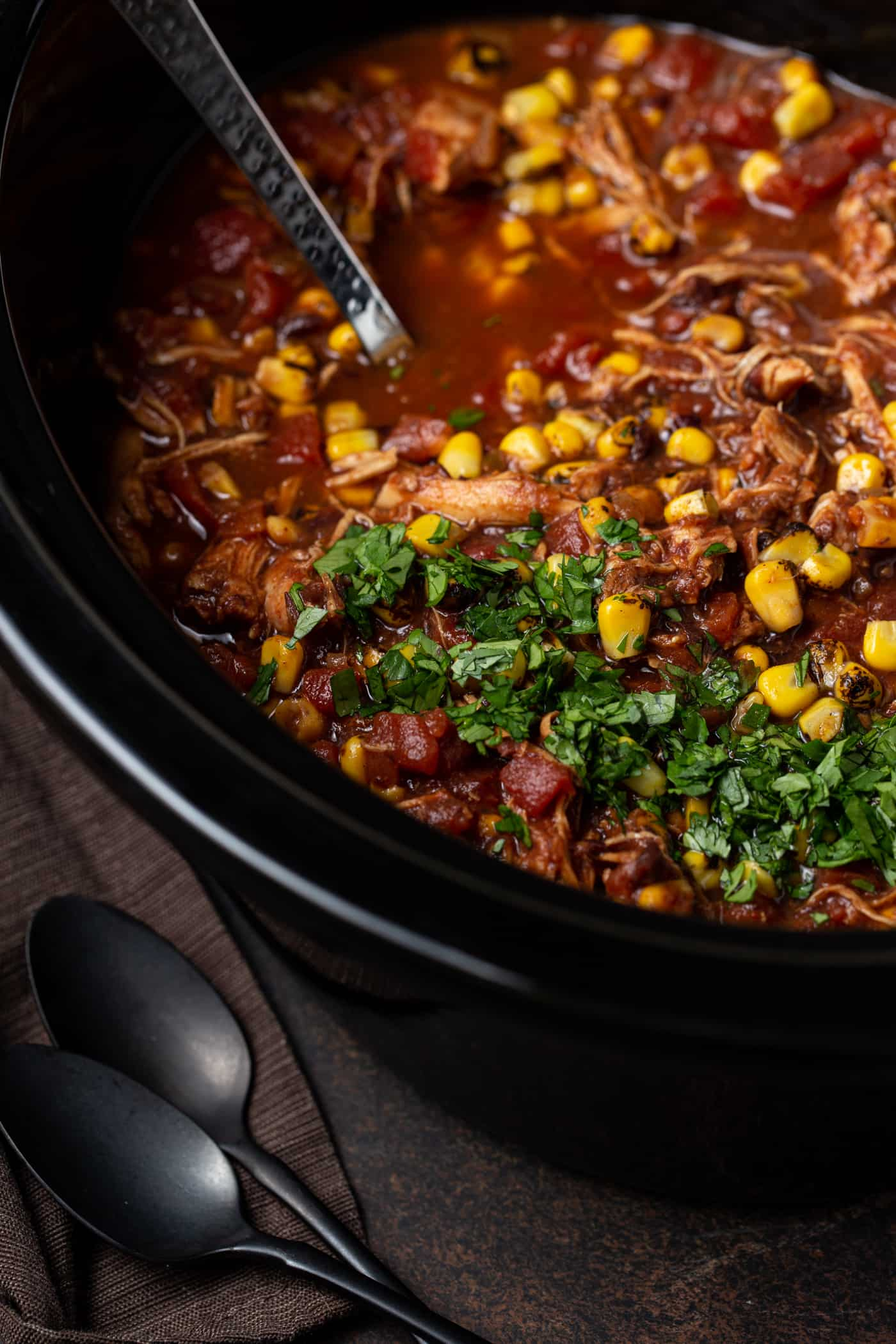 black slow cooker with taco soup