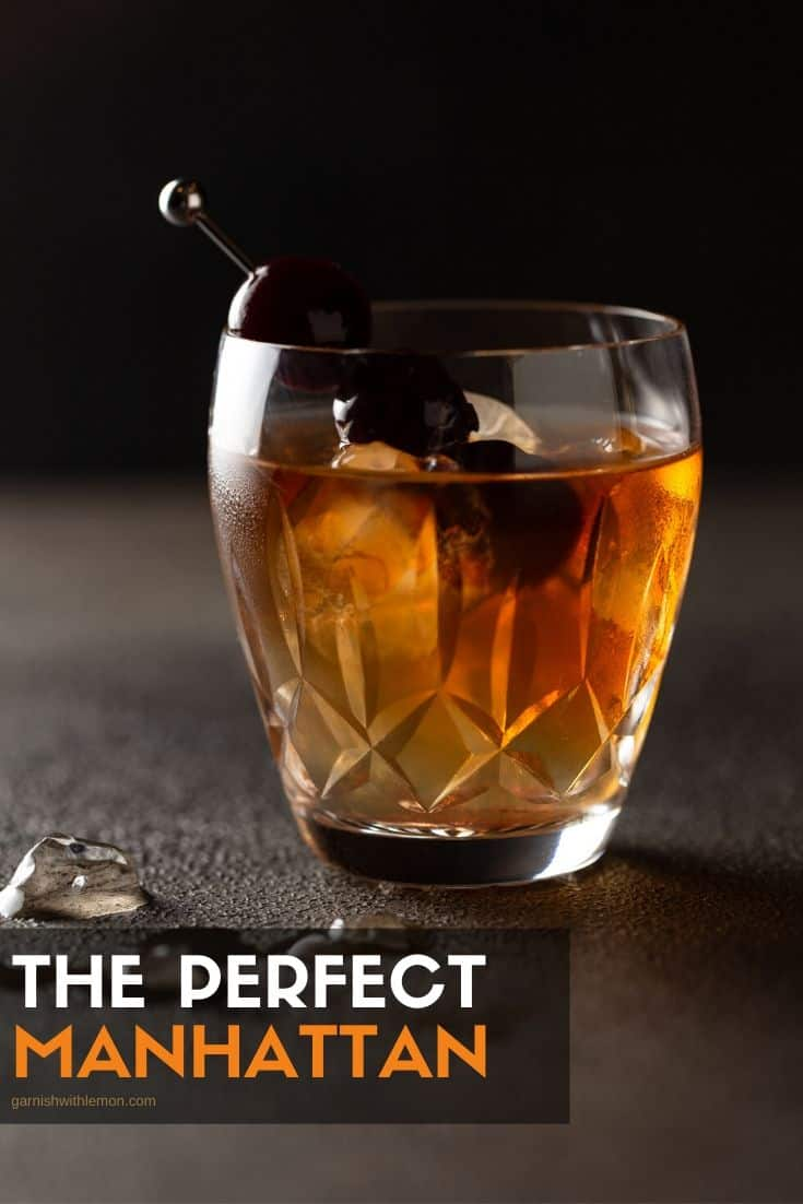 Pinterest image of single manhattan cocktail in a crystal old fashioned glass with a skewer of cherries for garnish.