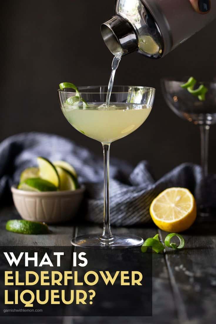 A cocktail shaker pouring an elderflower liqueur cocktail into a coupe glass.