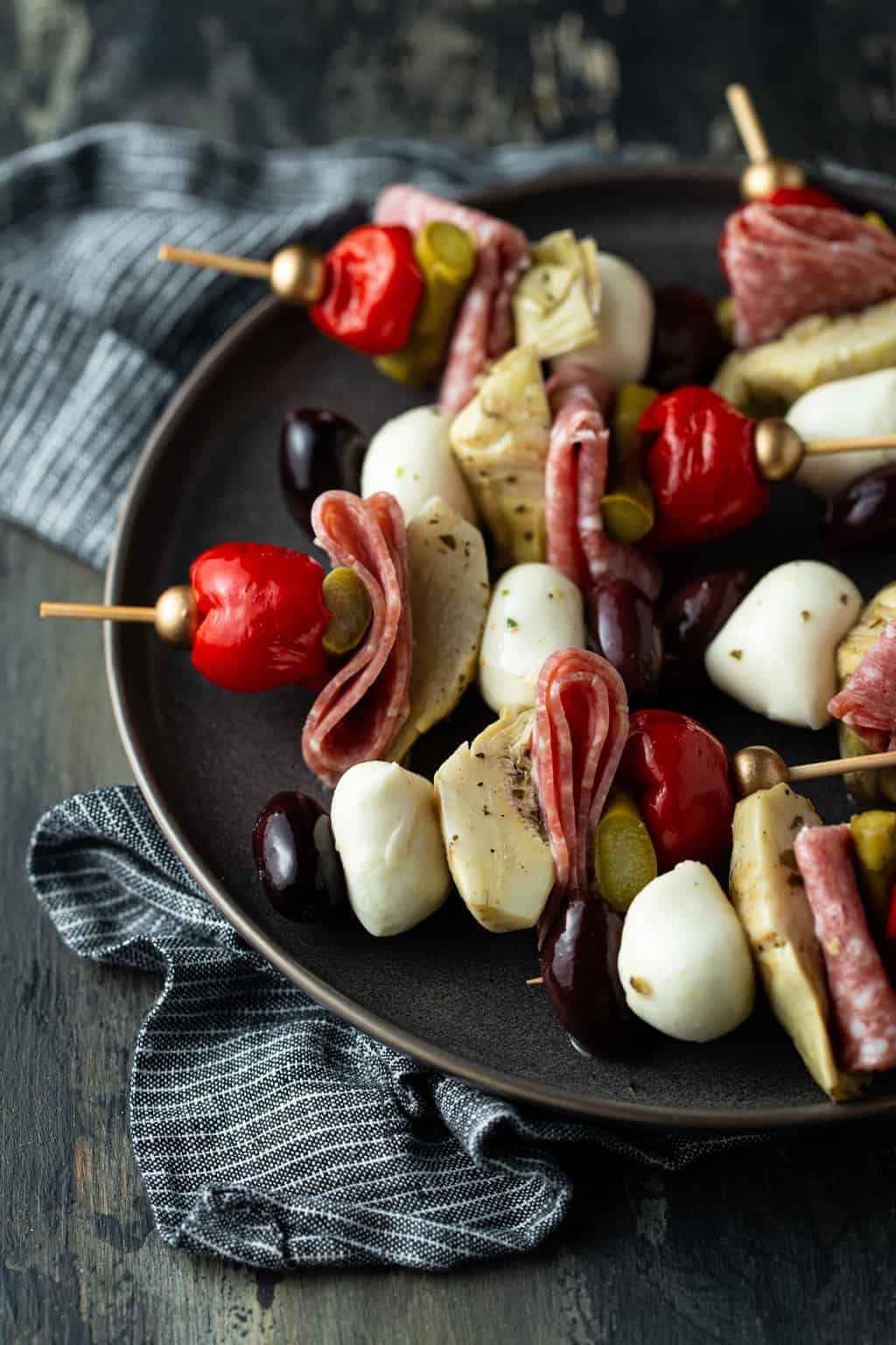 antipasto on a serving plate with a striped napkin.