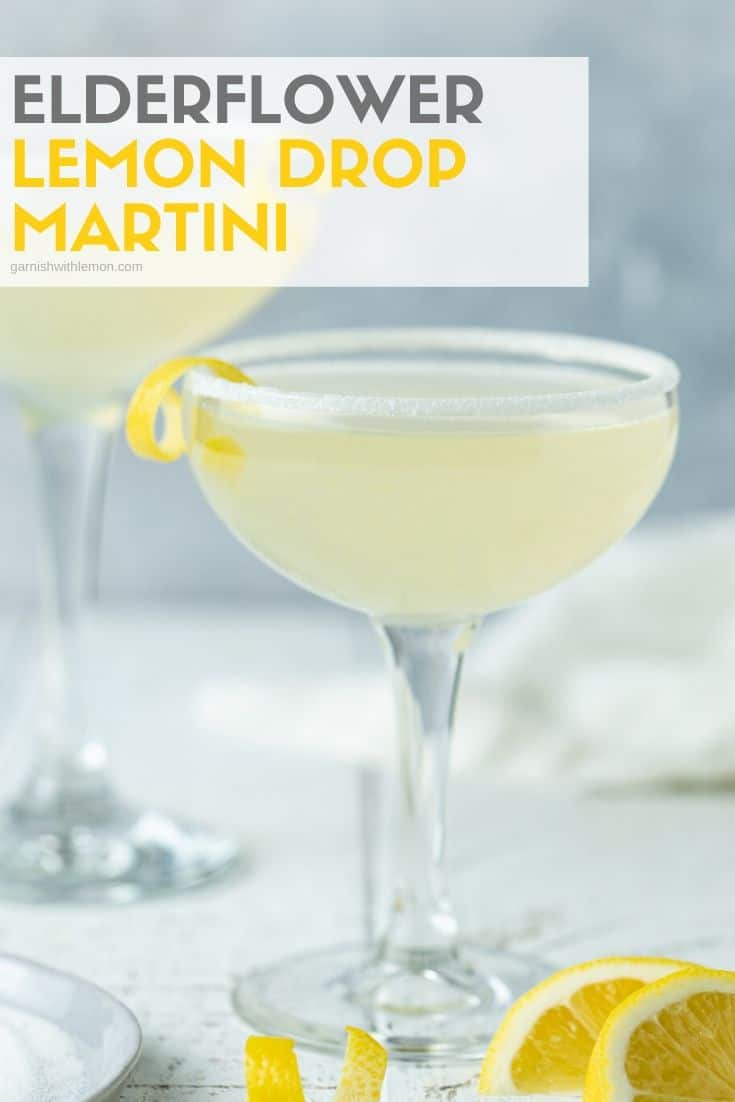 Pinterest image of Elderflower Lemon Drop Martinis in tall glasses with sugared rims on a white background.