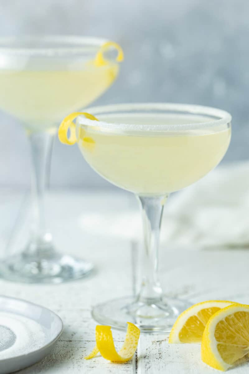 2 lemon drops with a white linen and a mottled gray background.