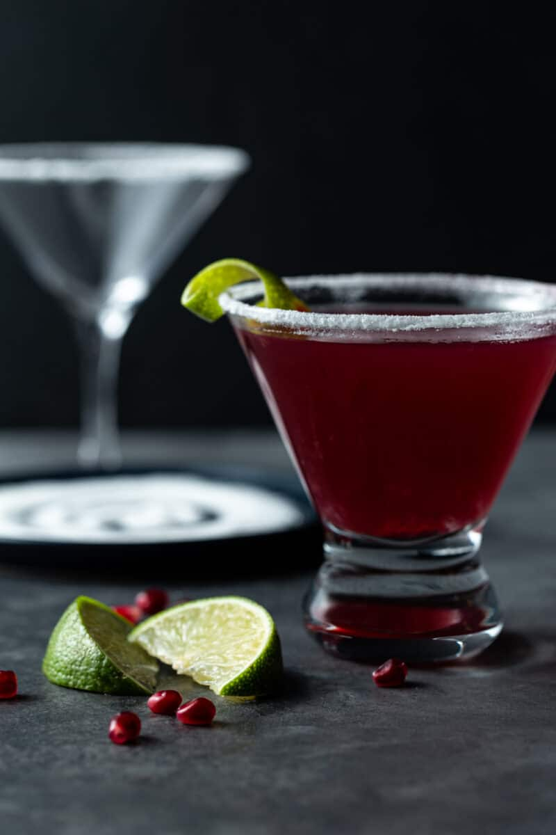 A close up of a glass of red juice, with Martini and Tequila.
