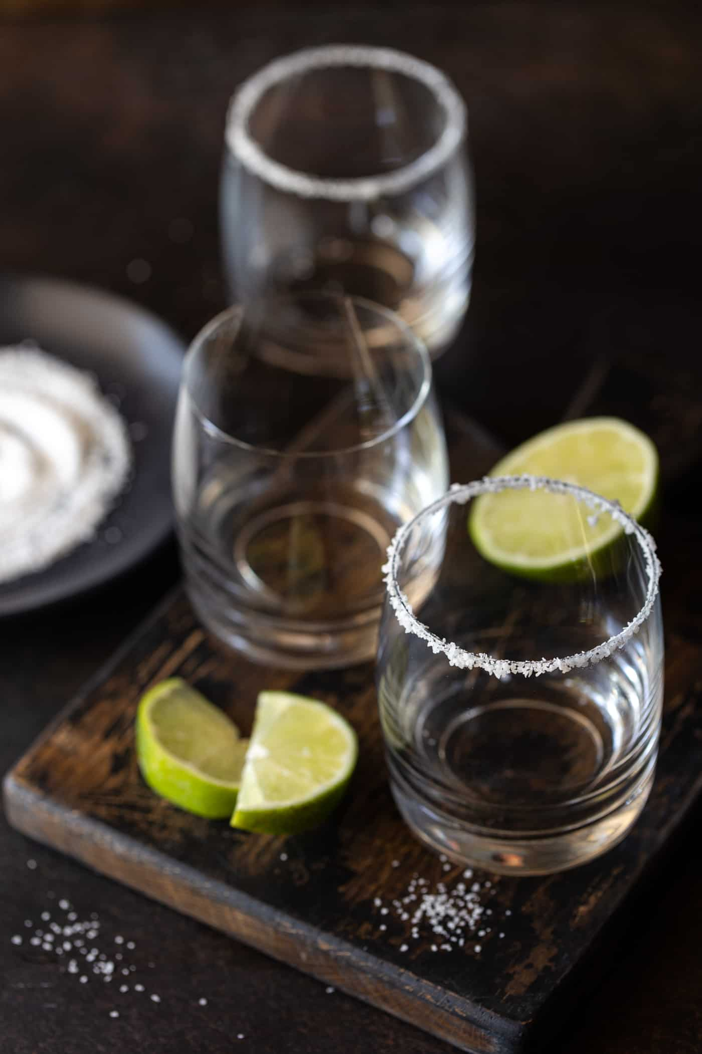 Empty lowball glasses rimmed with salt for margaritas