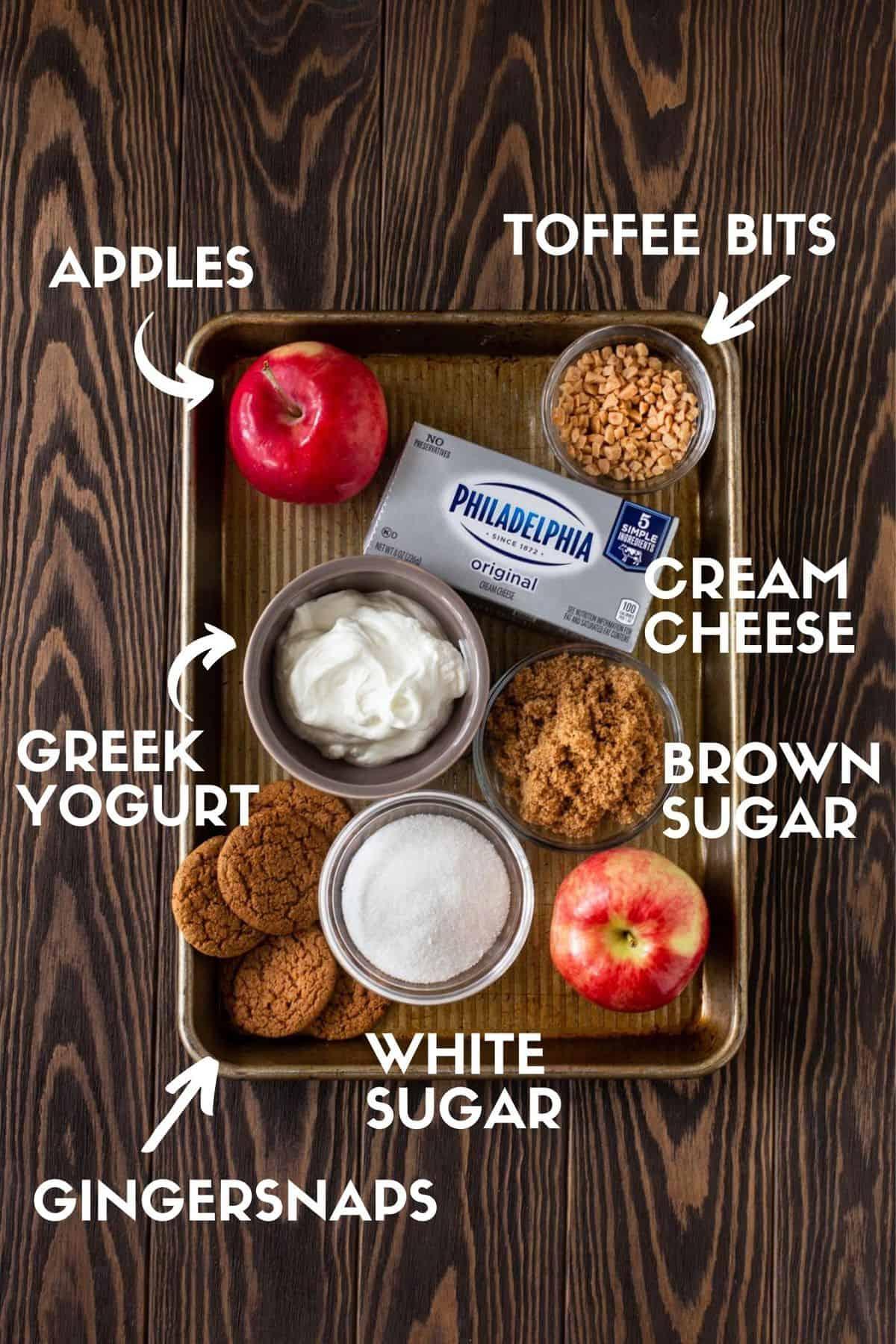 jelly roll pan with apple, toffee bits, cream cheese, greek yogurt, white sugar and brown sugar