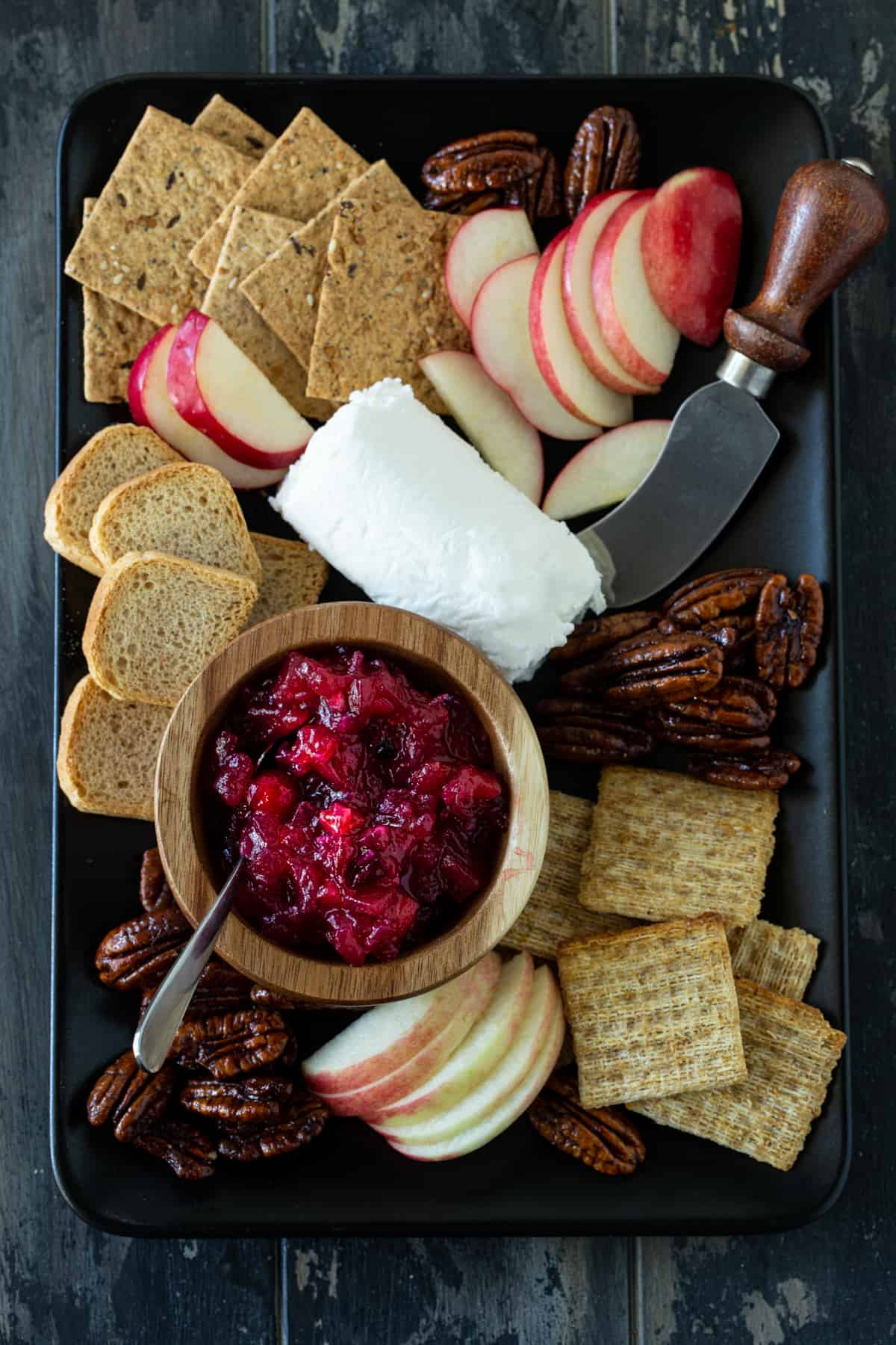 tray of cheese, crackers, nuts and chutney