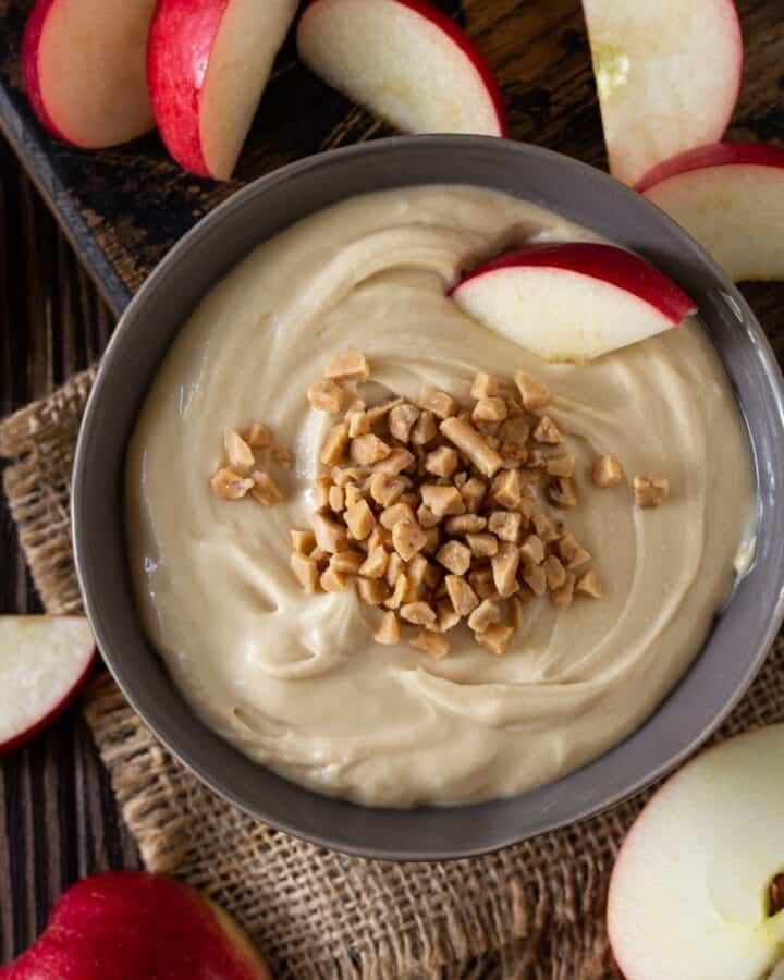 square image of cream cheese apple dip in grey bowl