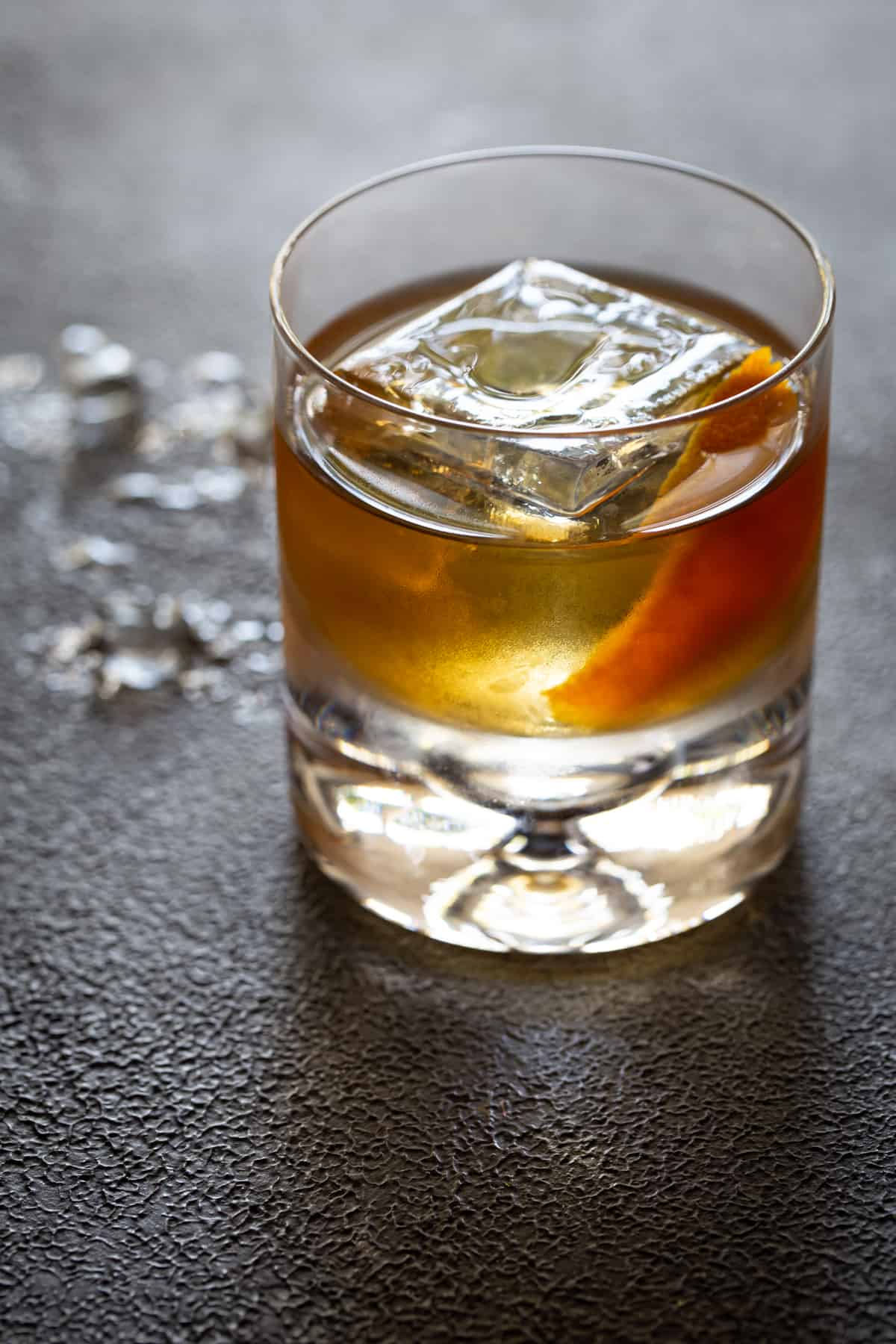 A glass with Old fashioned and Whiskey cocktail.