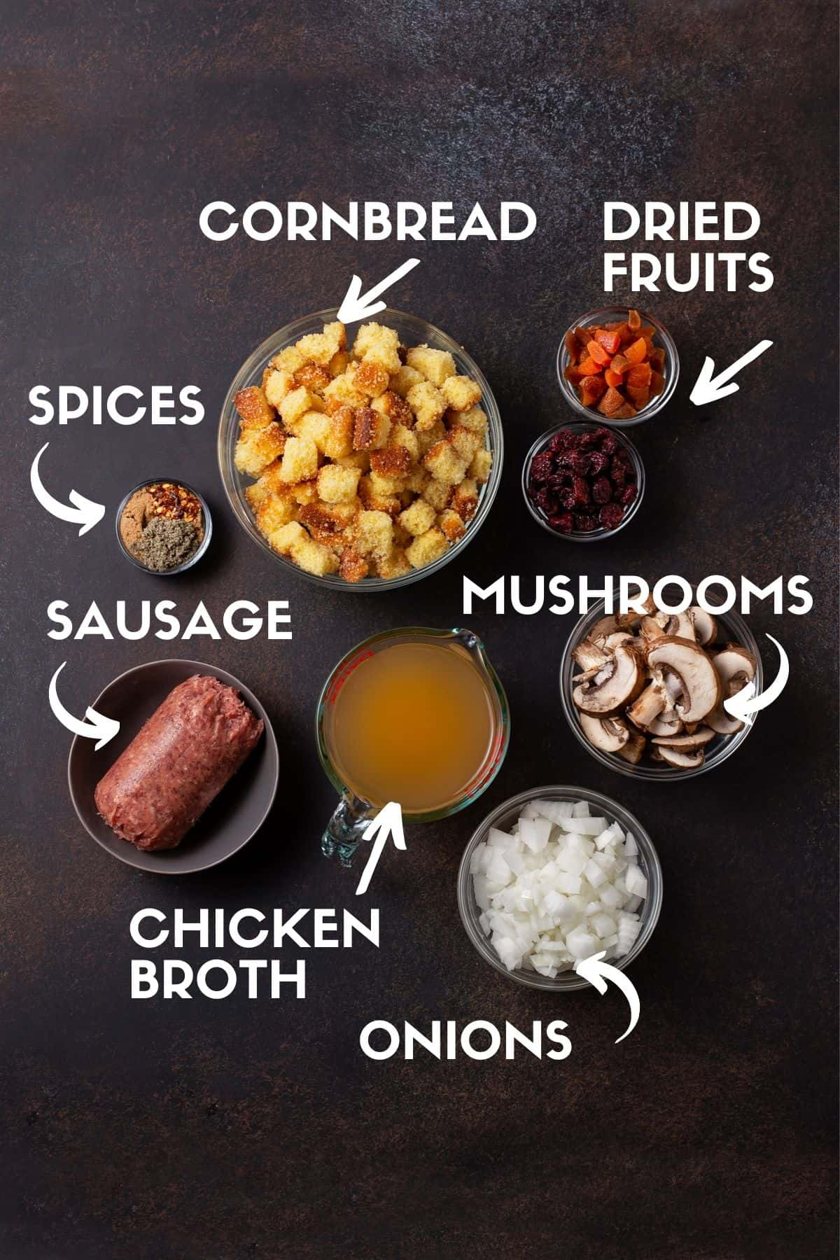 ingredients for cornbread stuffing including sausage, cornbread, onions, mushrooms, chicken broth, dried fruits and spices.