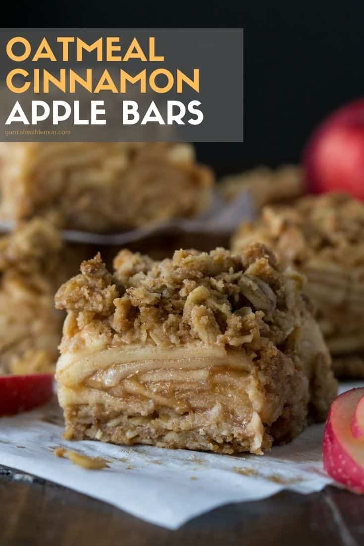 Slices of cinnamon apple bars on parchment paper