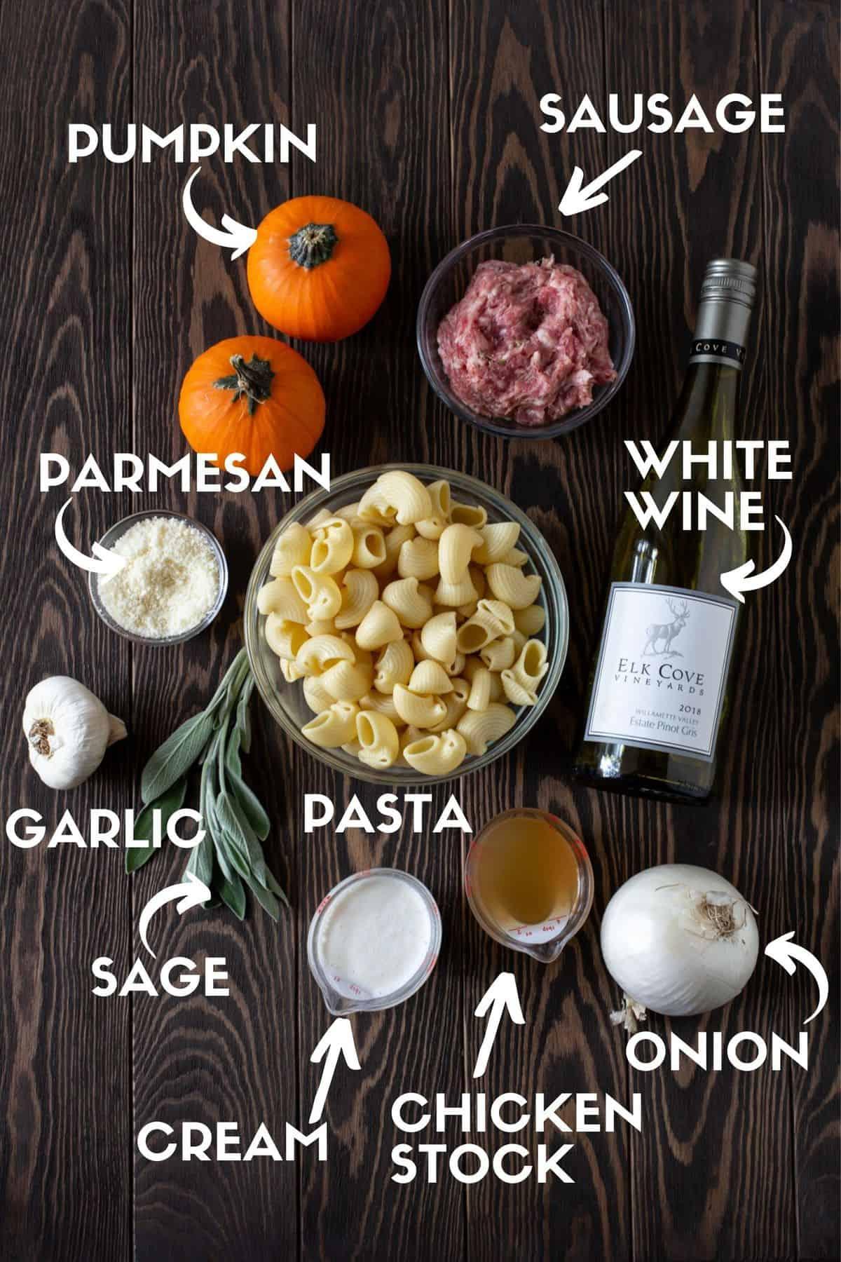 pumpkin pasta ingredients including sausage, sage leaves, onion, garlic, pumpkin and cream.