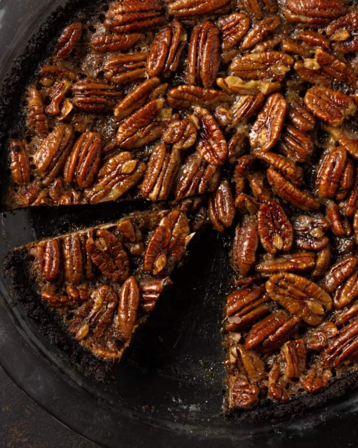 close up of pecan pie with chocolate crust.
