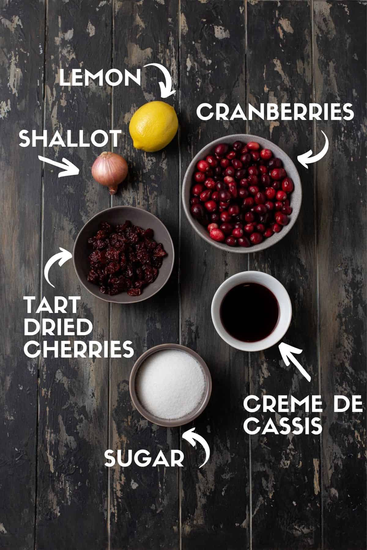 Fresh cranberries, creme de cassis, dried cherries, sugar, shallots and lemon ingredients for cranberry sauce.