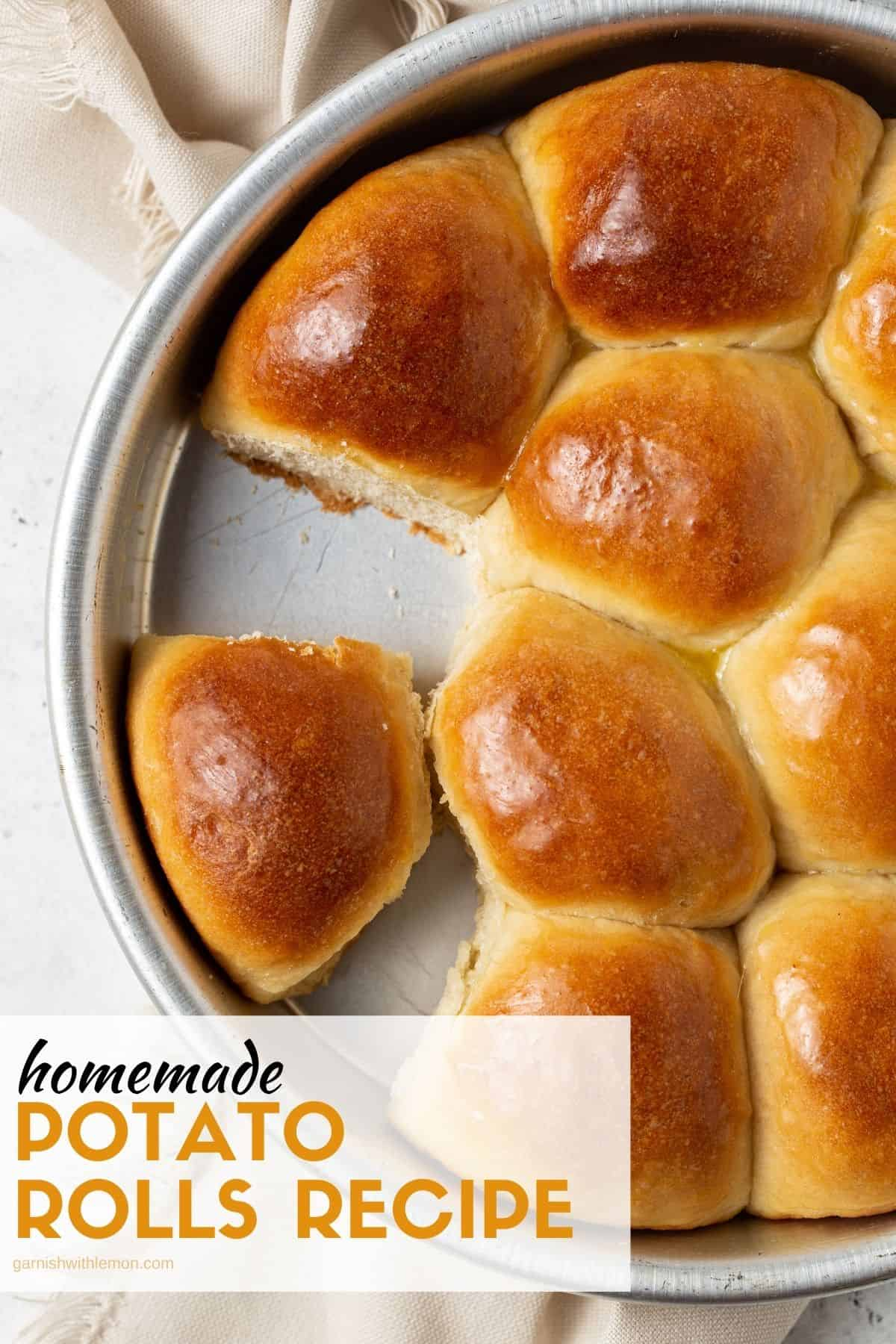 cake pan filled with baked potato rolls with one roll missing.