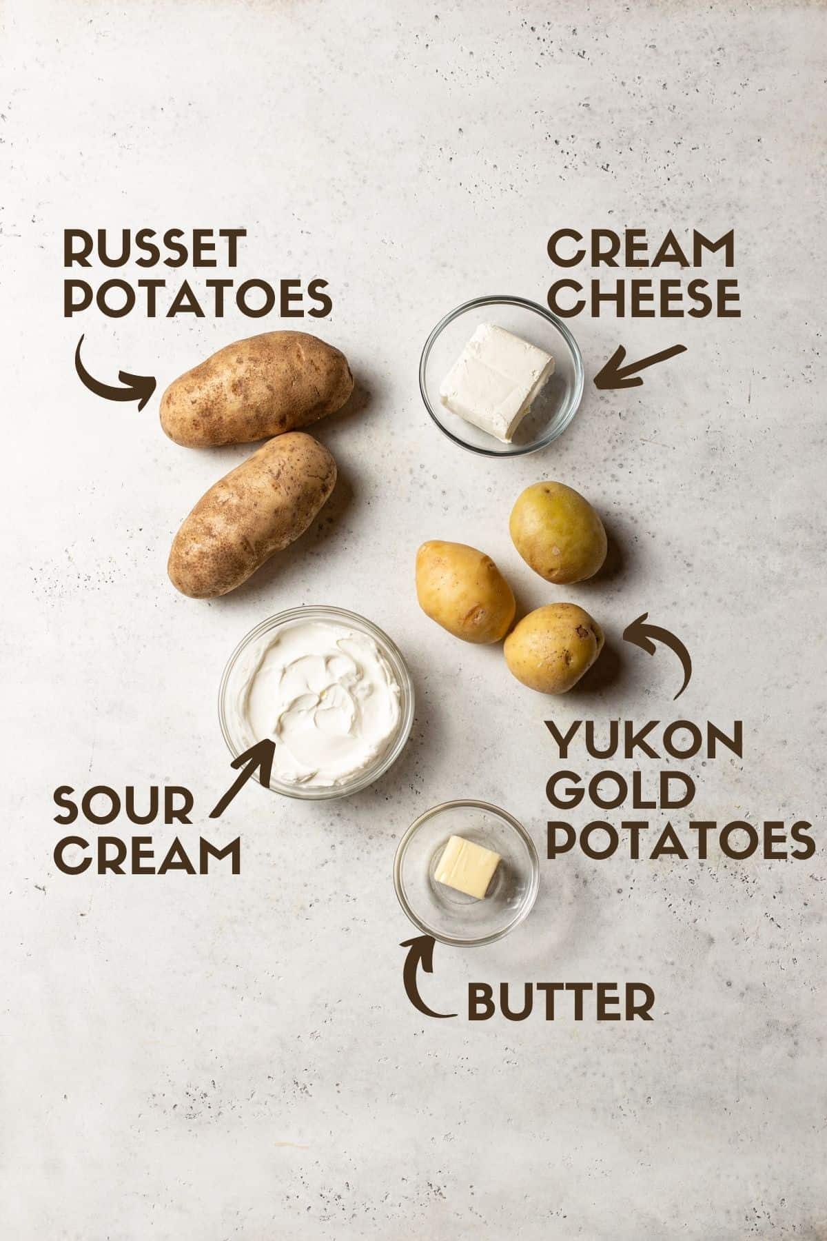 potatoes, sour cream, butter, cream cheese on white board
