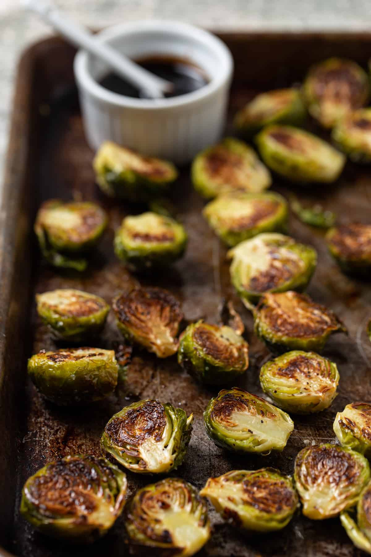 A close up of food, with Brussels sprout.
