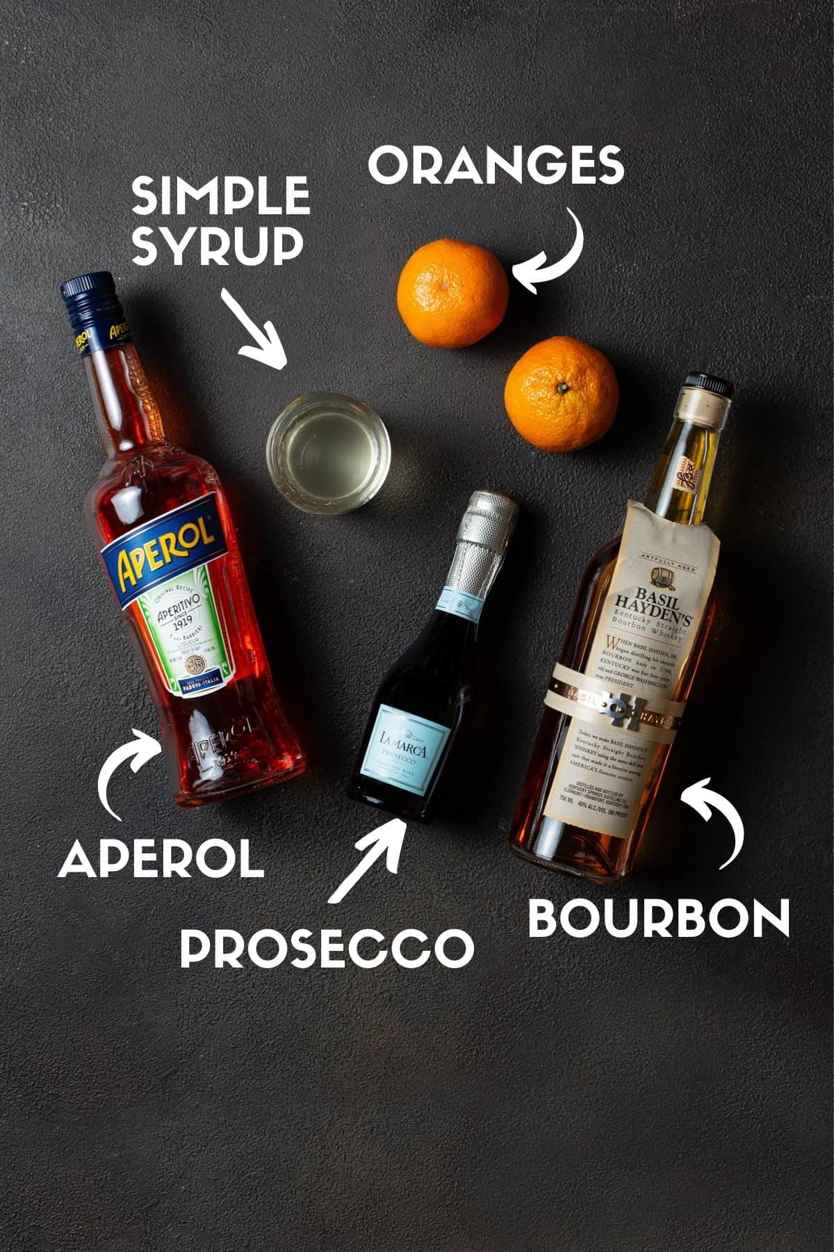 bottles of alcohol and oranges for making cocktails.