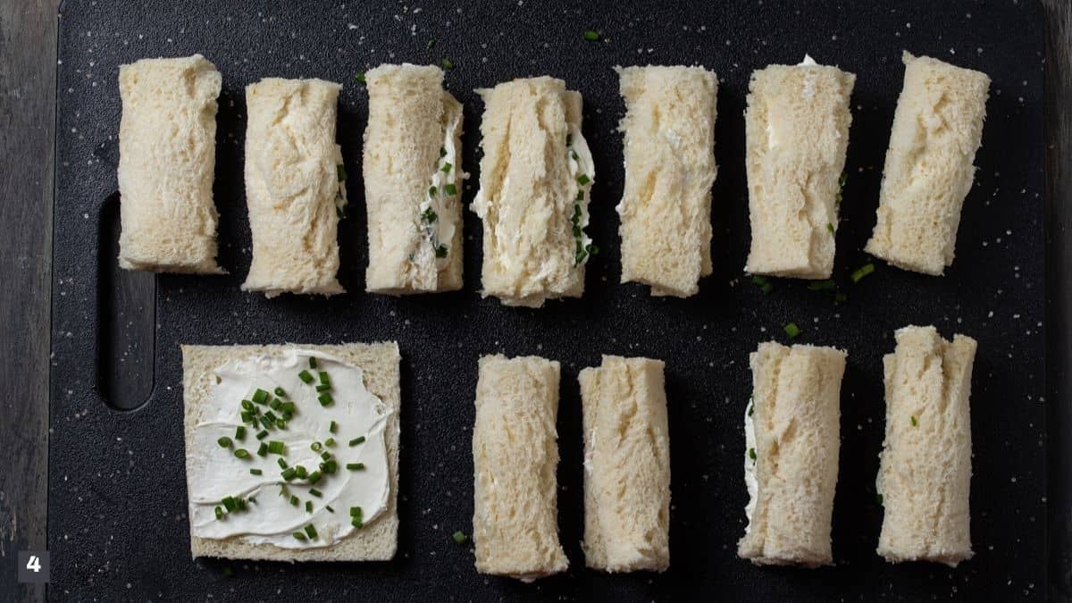 Pieces of bread rolled with cream cheese and chives.