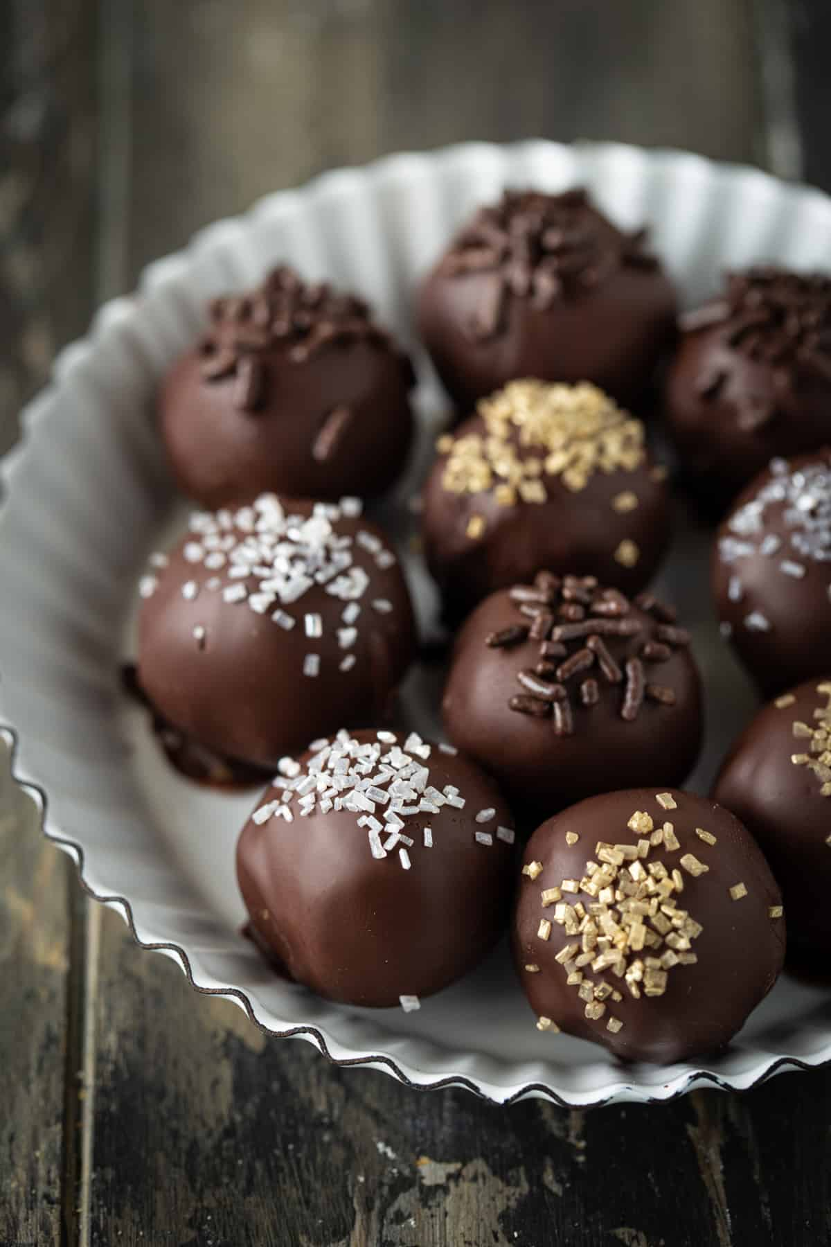 Decorated truffles in a small white metal fluted tart pan